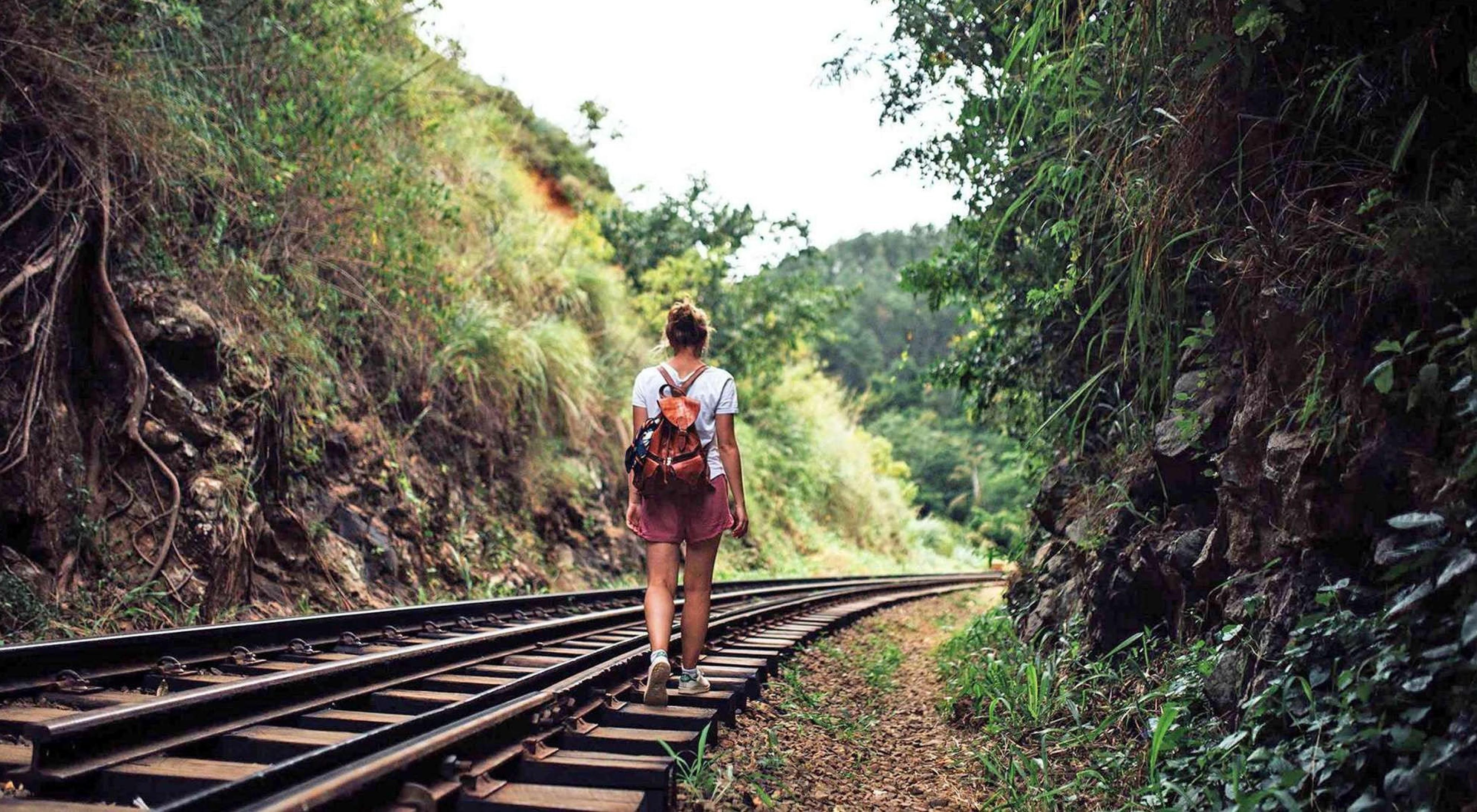 woman walking on railway track in Sri Lanka
